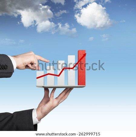 hand holding touch tablet with stock chart - stock photo