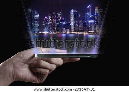 Hand holding transparent 3D smartphone. A 3D phone is a mobile phone that conveys depth perception to the viewer by employing stereoscopy or any other form of 3D depth techniques.  - stock photo