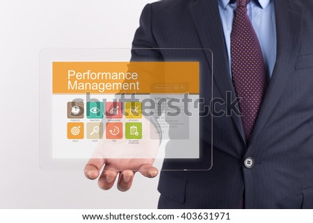 Hand Holding Transparent Tablet PC with Performance Management screen