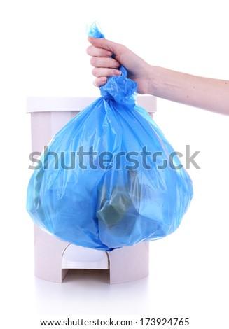 Hand holding trash bag, isolated on white - stock photo