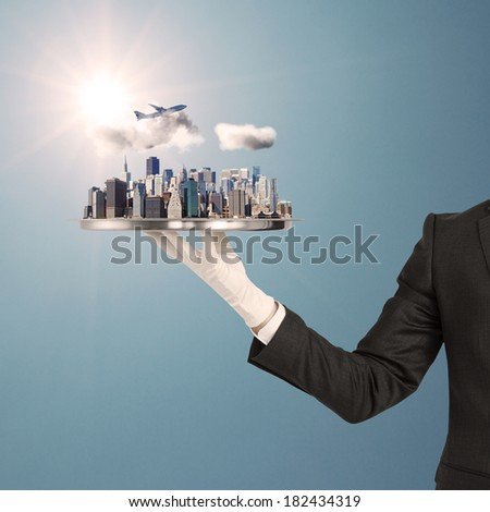 hand holding tray with modern city - stock photo