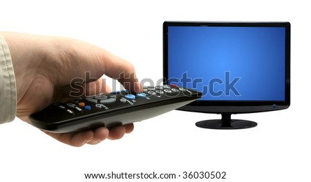Hand holding TV remote control. Isolated on a white background - stock photo
