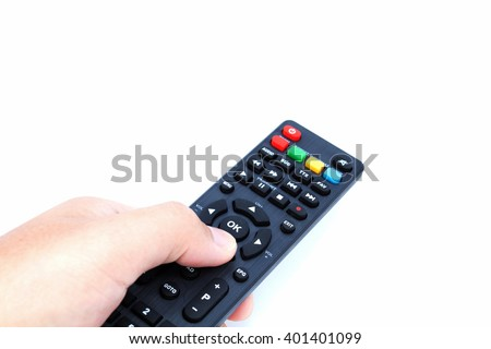 Hand holding TV remote control on white background - stock photo