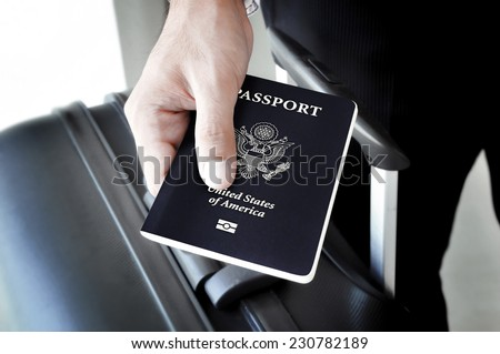Hand holding U.S. passport - stock photo