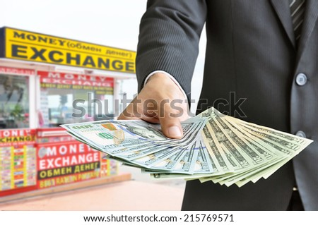 Hand holding US dollar bills - money exchange concept - stock photo