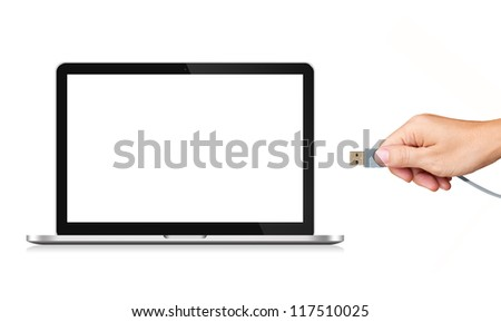 Hand holding USB cable with blank screen Laptop Computer - stock photo