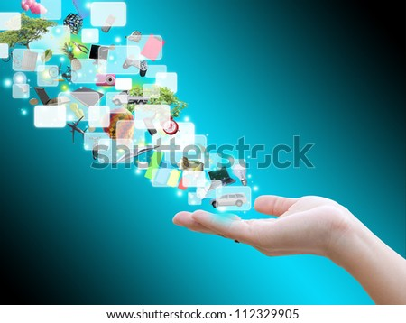 Hand holding virtual object - stock photo