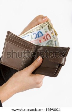 Hand holding wallet with foreign notes isolated on white
