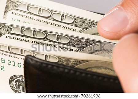 Hand holding wallet with money dollars