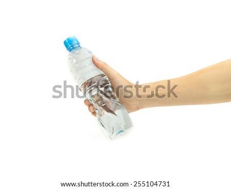 hand holding water bottle isolated on white background. - stock photo