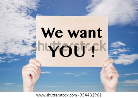 hand holding we want you! sign on blue sky background  - stock photo