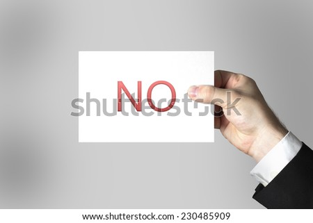 hand holding white card sign no refusal - stock photo