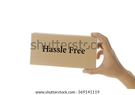 hand holding white card written hassle free  over white background