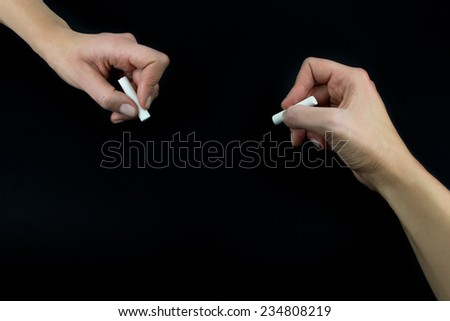Hand holding white chalk, set isolated on white background - stock photo