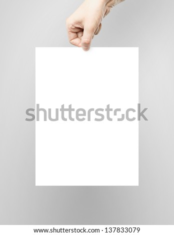 hand holding white paper poster - stock photo