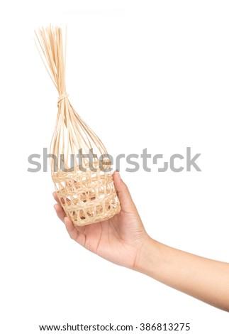 Hand holding Wicker round bamboo basket isolated on white background - stock photo