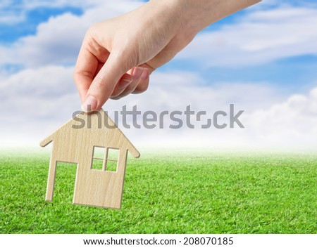 Hand holding wood home