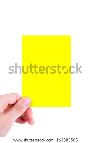 Hand holding yellow card, isolated on white background.