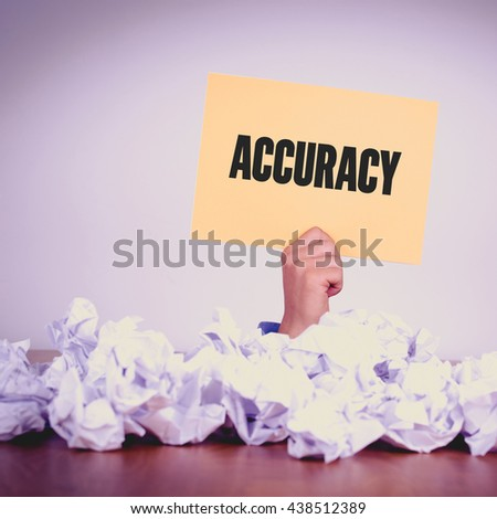 HAND HOLDING YELLOW PAPER WITH ACCURACYCONCEPT - stock photo