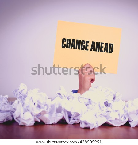 HAND HOLDING YELLOW PAPER WITH CHANGE AHEADCONCEPT - stock photo