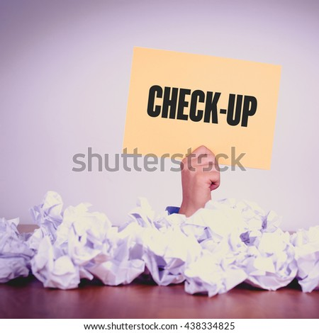 HAND HOLDING YELLOW PAPER WITH CHECK-UP CONCEPT - stock photo