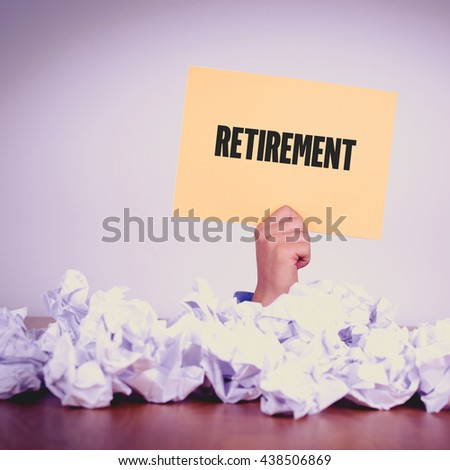 HAND HOLDING YELLOW PAPER WITH RETIREMENTCONCEPT - stock photo