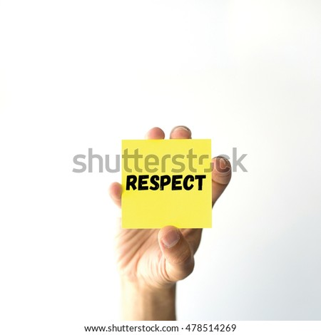 Hand holding yellow sticky note written RESPECT word