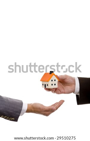 hand holdinh a small house - real state house credit concept - stock photo