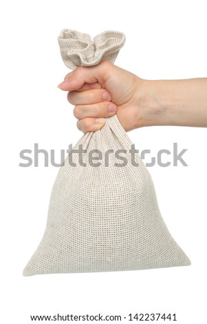 Hand holds bag on white background   - stock photo
