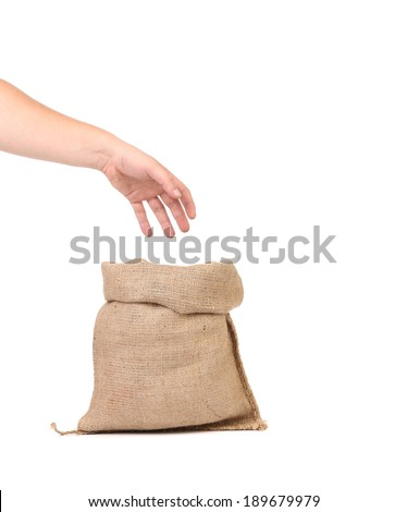 Hand holds bag with euro banknotes. Isolated on a white background. - stock photo