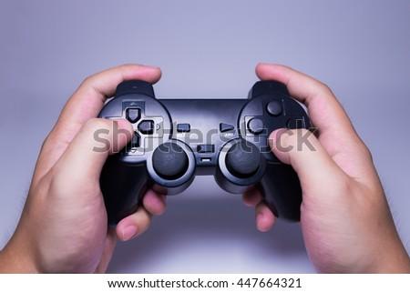 Hand holds black joystick , isolate on white background - stock photo