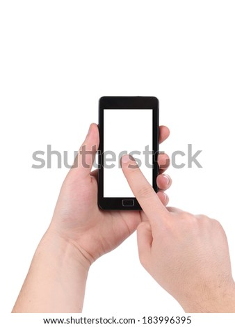 Hand holds cell phone with clipping path. Isolated on a white background.
