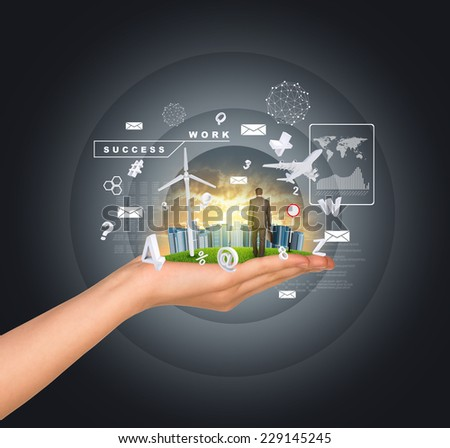 Hand holds city of skyscrapers on green grass and businessman walking forward. Flying letters near hand. Business concept - stock photo