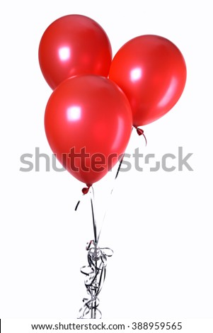 Hand holds colorful balloons isolated on white - stock photo