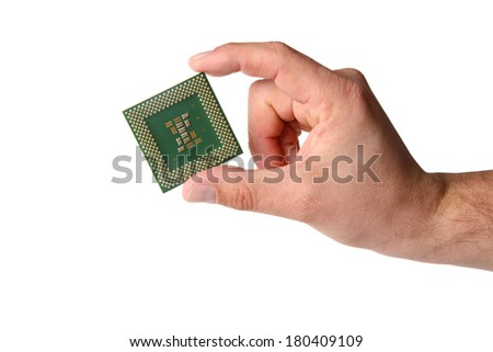 Hand holds computer CPU processor chip, cut out on white background - stock photo