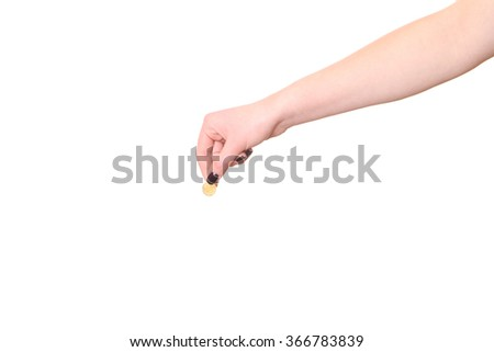 Hand holds euro cent on white background - stock photo
