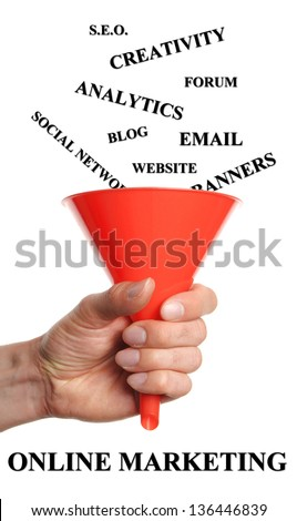 Hand holds funnels by fall words into that are necessary for a successful online marketing - stock photo