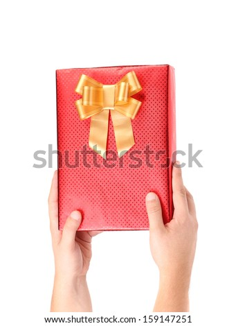 Hand holds gift box. Isolated on a white background. - stock photo