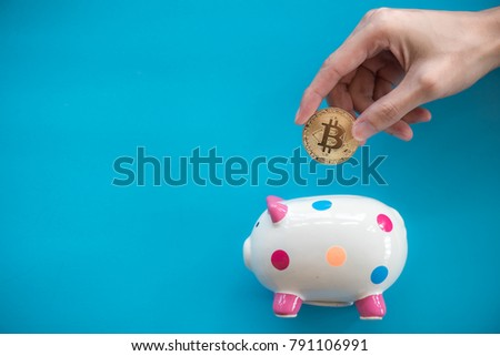 hand holds gold bitcoin money. saving concept