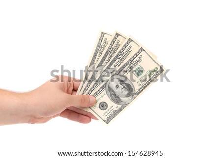 Hand holds one hundred bancknotes. Close up - stock photo