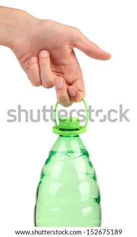 Hand holds plastic bottle. - stock photo
