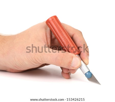Hand holds plastic Craft Knife on a white background - stock photo