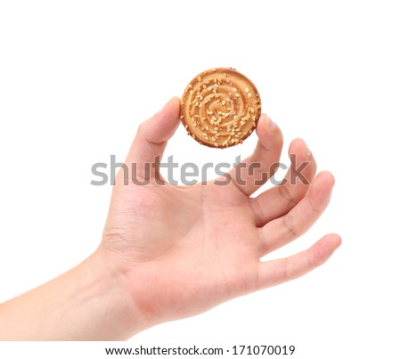 Hand holds sesame cake.  Isolated on white background