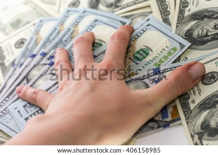 hand holds the hundred-dollar bills Hand with money, 100 dollar bills, receive money in the bank - stock photo