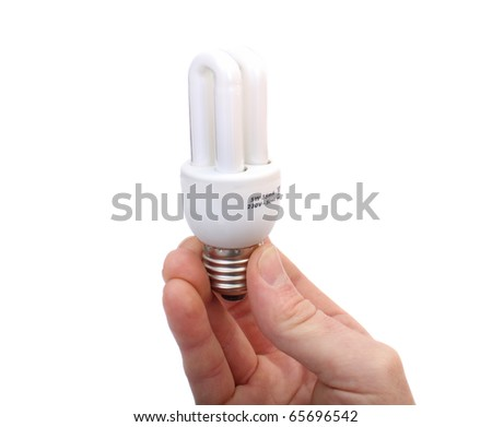 hand holds the lamp electrical economical white - stock photo