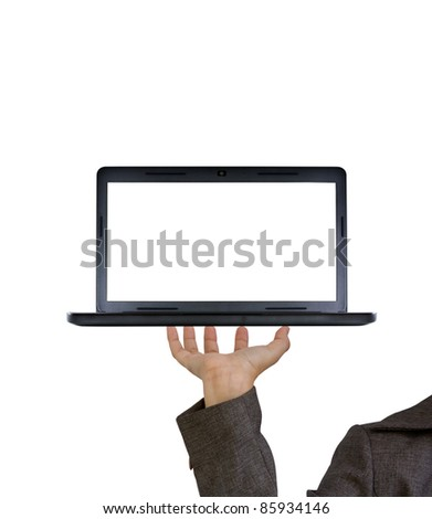 Hand holds the laptop on fingers as a tray - stock photo