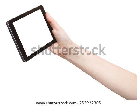 hand holds touchpad with cutout screen isolated on white background - stock photo