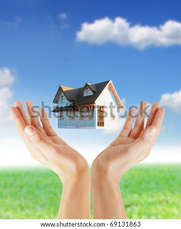 Hand house - stock photo