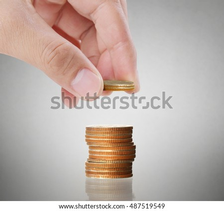 Hand human hand putting coin to money, business ideas