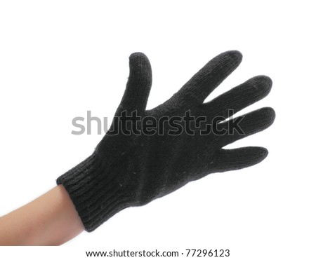 hand in a black woollen glove on a white background - stock photo